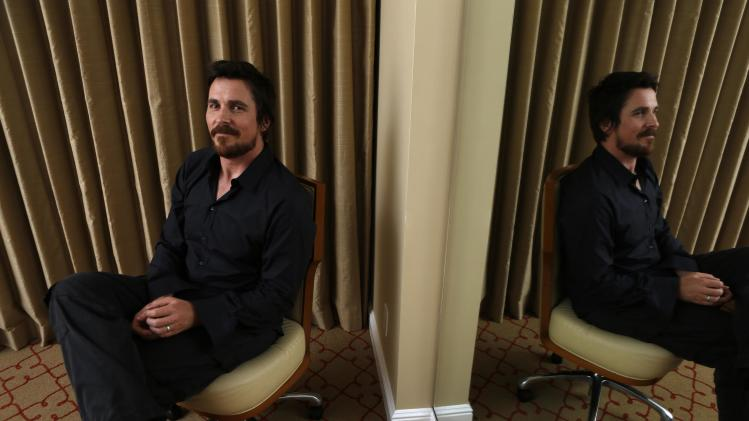 "British actor Christian Bale poses for a portrait while promoting his upcoming movie ""Out of the Furnace"" in Los Angeles, California"