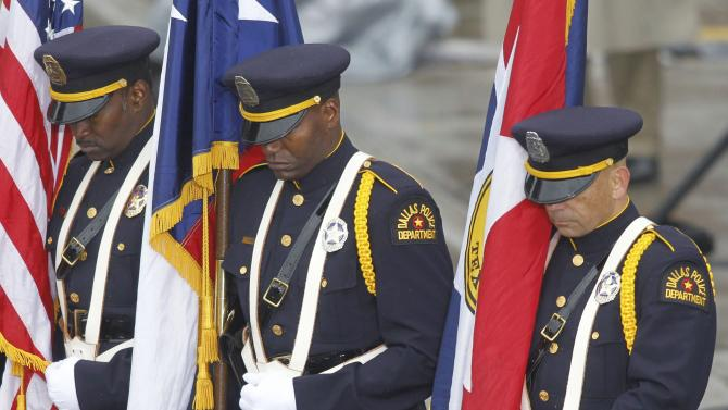 Members of a Dallas Police Department honor guard stand in Dealey Plaza during ceremonies marking the 50th anniversary of JFK's assassination in Dallas