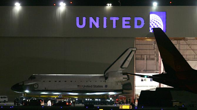 The space shuttle Endeavour is moved out of the United hangar at Los Angeles International Airport just before midnight Thursday, Oct. 11, 2012 to begin its two-day trek across Los Angeles and Inglewood to the California Science Center where it will be on permanent display. (AP Photo/Los Angeles Times, Bryan Chan, Pool)