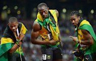 Jamaica&#39;s Usain Bolt (C) celebrates with teammates Yohan Blake (R) and Warren Weir after winning the men&#39;s 200m final at the athletics event during the London 2012 Olympic Games, on August 9. Jamaica&#39;s sprint kings will enter the home stretch of their golden Olympic campaign on Friday, as they return to the track for the 4x100 relay