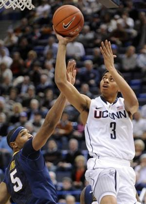 Lamb leads No. 17 UConn over West Virginia 64-57
