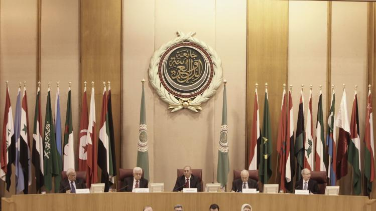 Dignitaries attend Arab League Foreign Ministers emergency meeting at the League's headquarters in Cairo
