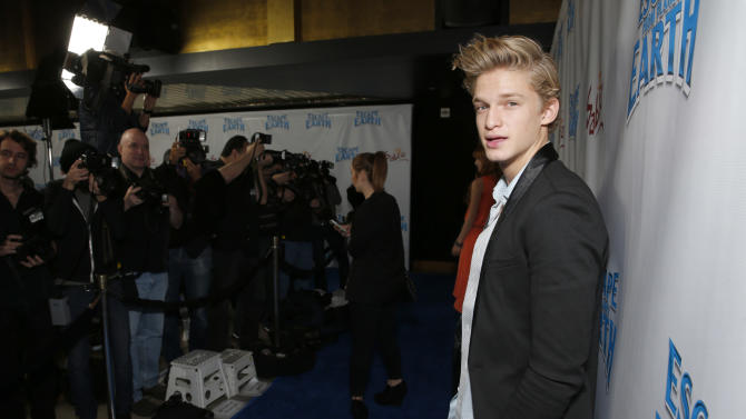 """Cody Simpson attends the LA premiere of """"Escape from Planet Earth"""" at the Chinese Theater on Saturday, Feb. 2,2013 in Hollywood. (Photo by Todd Williamson/Invision/AP Images)"""