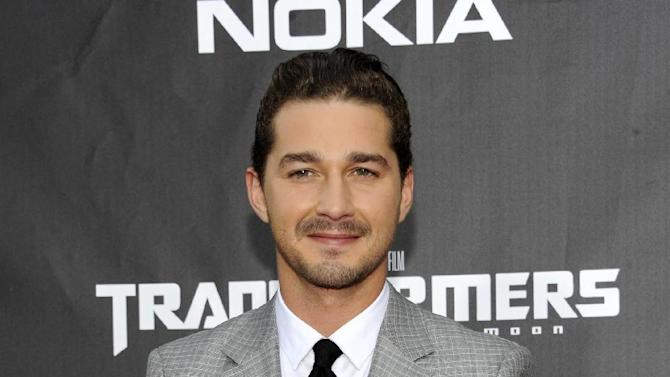 "FILE - This June 28, 2011 file photo shows actor Shia LaBeouf attending the ""Transformers: Dark of the Moon"" premiere in Times Square in New York. LaBeouf will join fellow actor Alec Baldwin as he makes his Broadway debut in ""Orphans."" The play will begin performances on March 19 and open on April 7, 2013 at the Schoenfeld Theatre in New York. (AP Photo/Evan Agostini, file)"