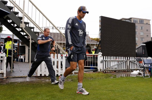 England's captain Cook walks out onto the ground with team coach Flower on final day second test against New Zealand in Wellington