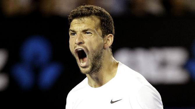 Grigor Dimitrov of Bulgaria celebrates a point won against Andy Murray of Britain during their fourth round match at the Australian Open tennis championship in Melbourne, Australia, Sunday, Jan. 25, 2015. (AP Photo/Bernat Armangue)