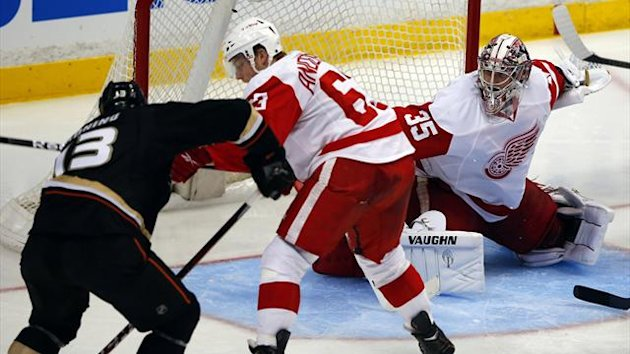 Anaheim Ducks center Nick Bonino (13) score on Detroit Red Wings goalie Jimmy Howard (35) in over-time during Game 5 of their NHL Western Conference quarterfinal hockey playoff (Reuters)