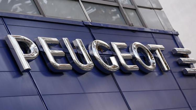Exterior view of a Peugeot automobile dealer is seen in Paris after US alliance partner GM sold its stake in the French carmaker
