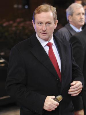 Irish Prime Minister Enda Kenny, left, arrives for an EU summit in Brussels on Thursday, Dec. 8, 2011. During a two-day summit German Chancellor Angela Merkel and French President Nicolas Sarkozy will try to build support for their plan for eurozone nations to submit their national budgets to much greater scrutiny. (AP Photo/Geert Vanden Wijngaert)