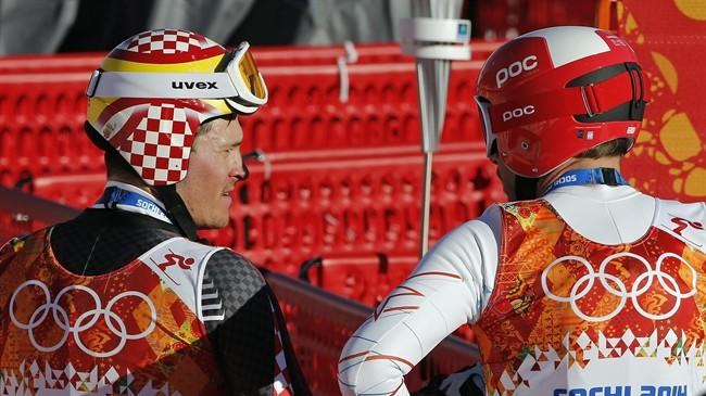United States' Bode Miller, right, chats with Croatia's Ivica Kostelic after completing men's downhill combined training at the Sochi 2014 Winter Olympics, Thursday, Feb. 13, 2014, in Krasnaya Polyana, Russia. (AP Photo/Christophe Ena)