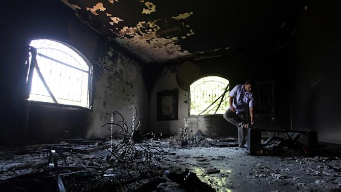 FILE - In this Thursday, Sept. 13, 2012 file photo, a Libyan man investigates the inside of the U.S. Consulate after an attack that killed four Americans, including Ambassador Chris Stevens, on the night of Tuesday, Sept. 11, 2012, in Benghazi, Libya. House Republicans insist the Obama administration is covering up information about the deadly assault on the U.S. diplomatic mission in Benghazi, Libya, last year, rejecting administration assurances to the contrary and stoking a controversy with implications for the 2016 presidential race. (AP Photo/Mohammad Hannon, File)