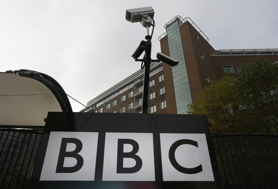 Cameras are seen above a sign at the BBC Television Centre, in London Wednesday, Oct. 24, 2012. The BBC is facing questions over sexual abuse allegations against former television presenter Jimmy Savile. (AP Photo/Kirsty Wigglesworth)