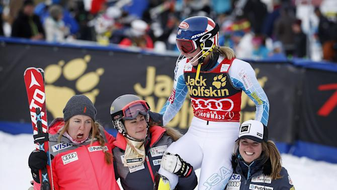 United States' Mikaela Shiffrin, second from right, celebrates after finishing her second run during the women's World Cup slalom ski race Sunday, Nov. 29, 2015, in Aspen, Colo. (AP Photo/Brennan Linsley)