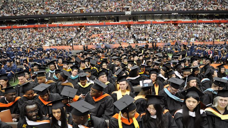 IMAGE DISTRIBUTED FOR SYRACUSE UNIVERSITY - Graduates settle in before the start of Syracuse University 159th Commencement ceremony in Syracuse, N.Y., Sunday, May 12, 2013. (Kevin Rivoli / AP Images for Syracuse University)
