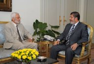 Picture released by the Egyptian presidency shows President Mohamed Morsi (R) meeting with the Head of the Supreme Judicial Council, Hossam al-Gheriani. Morsi will respect a court ruling overturning his decree for the dissolved Islamist-dominated parliament to convene, his office said amid a power struggle with the military