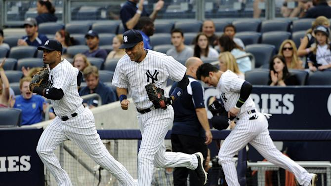 FILE - In this Aug. 3, 2012, file photo, New York Yankees shortstop Derek Jeter, center, runs onto the field with Robinson Cano, left, and Nick Swisher at the start of their baseball game against the Seattle Mariners at Yankee Stadium in New York. Secondary ticket websites are drawing increased attention from sports teams concerned about the effect of the low-price seats on their ability to sell their remaining inventory. (AP Photo/Kathy Kmonicek, File)