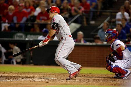 Angels' playoff hopes alive with win over Rangers