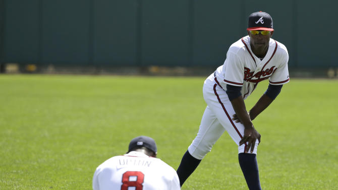 Atlanta Braves outfielders Justin Upton (8) and his brother B.J. Upton stretch before an exhibition baseball game against the Detroit Tigers on Friday, Feb. 22, 2013, in Kissimmee, Fla. (AP Photo/David J. Phillip)