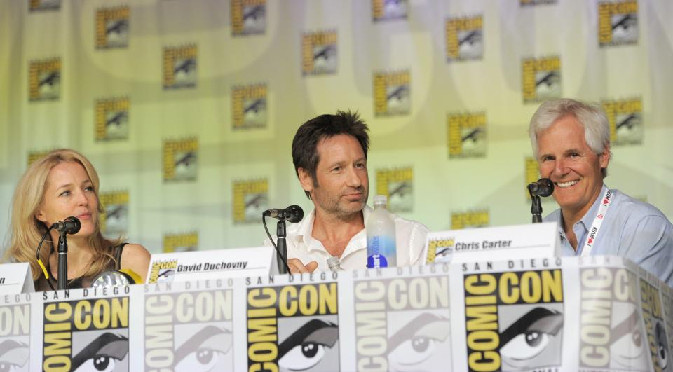 "Gillian Anderson, left, David Duchovny, center, and Chris Carter attend the ""The X Files"" 20th Anniversary panel on Day 2 of Comic-Con International on Thursday, July 18, 2013 in San Diego, Calif. (Photo by Chris Pizzello/Invision/AP)"