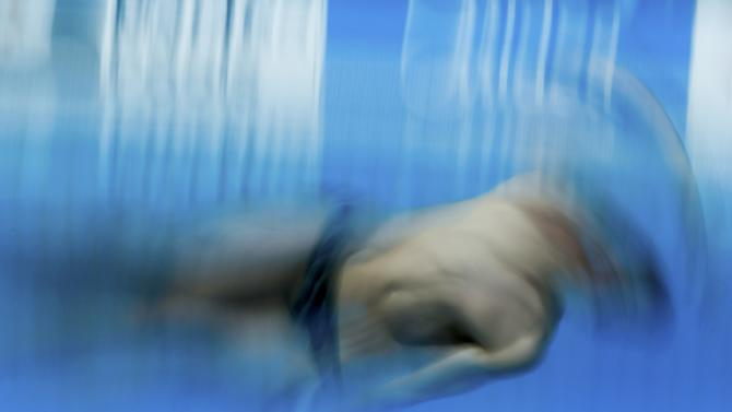 Connor of Australia performs a jump during the men's 3m springboard semi-final at the Aquatics World Championships in Kazan