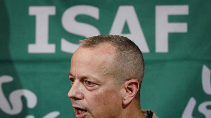 """FILE - In this Wednesday, Sept. 14, 2011 file photo, U.S. Gen. John Allen, then top commander of U.S. and NATO forces in Afghanistan, speaks during a news conference in Kabul, Afghanistan. Allen is under investigation for thousands of alleged """"inappropriate communications"""" he had with a Florida socialite also involved in the David Petraeus case. Nearly two dozen generals have commanded troops from the United States and the NATO-led International Security Assistance Force, since the American invasion in late 2001. While some analysts say fresh eyes are important, others wonder if the revolving door command has hurt U.S. continuity with critical Afghan partners. (AP Photo/Musadeq Sadeq, File)"""