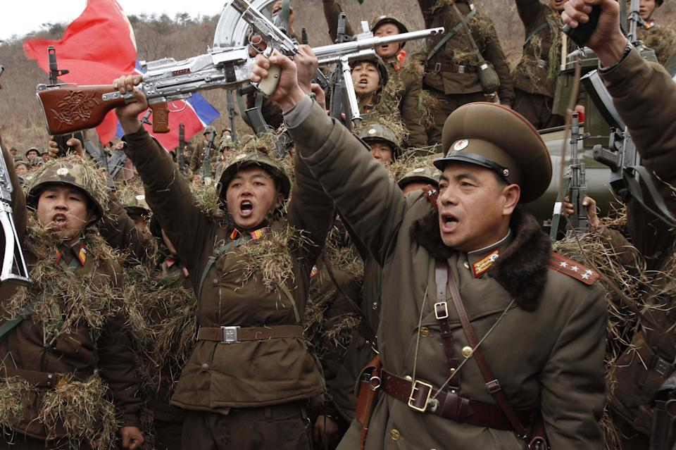 North Korean soldiers chant denunciations of South Korean President Lee Myung-bak at a North Korean military base on North Korea's southwest coast, opposite South Korea's Baengnyeong Island Monday, March 5, 2012. (AP Photo/Kim Kwang Hyon)