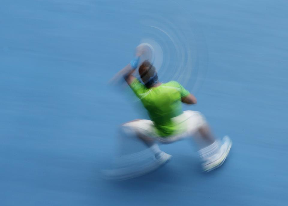 Spain's Rafael Nadal makes a forehand return to Slovakia's Lukas Lacko during their third round match at the Australian Open tennis championship, in Melbourne, Australia, Friday, Jan. 20, 2012. (AP Photo/John Donegan)