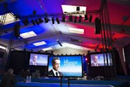A hall with video screens representing campaign posters of France&#39;s incumbent president Nicolas Sarkozy is seen ahead of a rally in Avignon. He sued a website that claimed Moamer Kadhafi financed his 2007 presidential election, seeking to spin the charge in the crucial final week before France goes to the polls