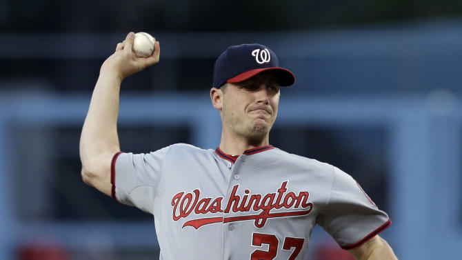 Washington Nationals starter Jordan Zimmermann  pitches to the Los Angeles Dodgers in the first inning of a baseball game in Los Angeles Monday, May 13, 2013. (AP Photo/Reed Saxon)