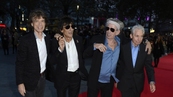 Mick Jagger, Ronnie Wood, Keith Richards, Charlie Watts of The Rolling Stones poses at London Film Festival American Express Gala The Rolling Stones - Crossfire Hurricane at Odeon West End on Thursday October 18, 2012  in London. (Photo by Jon Furniss/Invision)