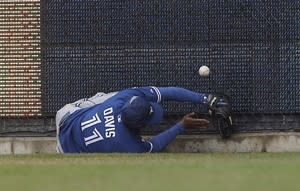 Toronto Blue Jays right fielder Rajai Davis struggles to field the ball at the wall hit for an RBI triple by Detroit Tigers' Miguel Cabrera during the second inning of a baseball game in Detroit, Thursday, April 11, 2013. (AP Photo/Paul Sancya)