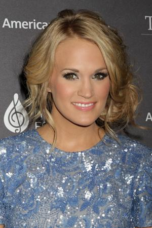 Carrie Underwood seen at the T.J. Martell Foundation 38th Honors Gala, on Tuesday, Oct. 22, 2013, in New York. (Photo by Greg Allen/Invision/AP)