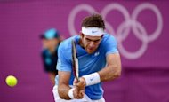 Argentina's Juan Martin del Potro returns the ball to Japan's Kei Nishikori during their men's single tennis quarterfinal match at the London 2012 Olympic Games. Del Potro won 6-4, 7-6 (7/4)