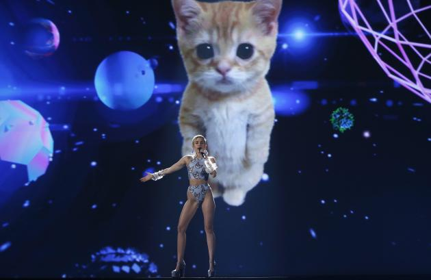"""Singer Miley Cyrus performs her single """"Wrecking Ball"""" at the 41st American Music Awards in Los Angeles, California November 24, 2013. Picture taken November 24, 2013. REUTERS/Lucy Nicholson (UNITED STATES - Tags: ENTERTAINMENT) (AMA-SHOW)"""