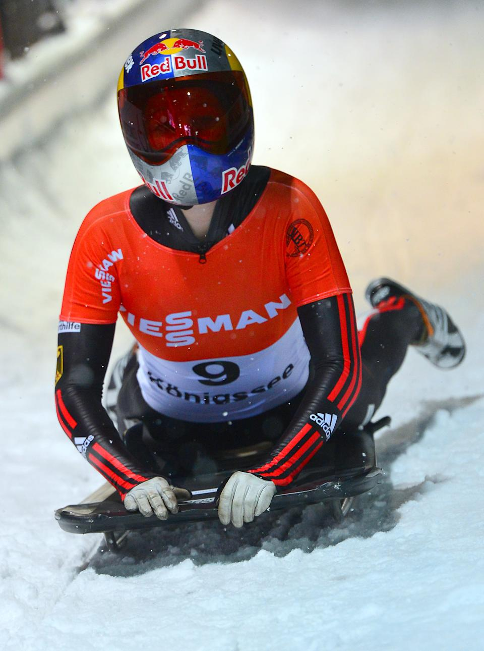 Germany's third placed Anja Huber in the finish area  after the women's Skeleton World Cup race  in Koenigssee, Germany, Friday, Jan. 11, 2013. (AP Photo/Kerstin Joensson)