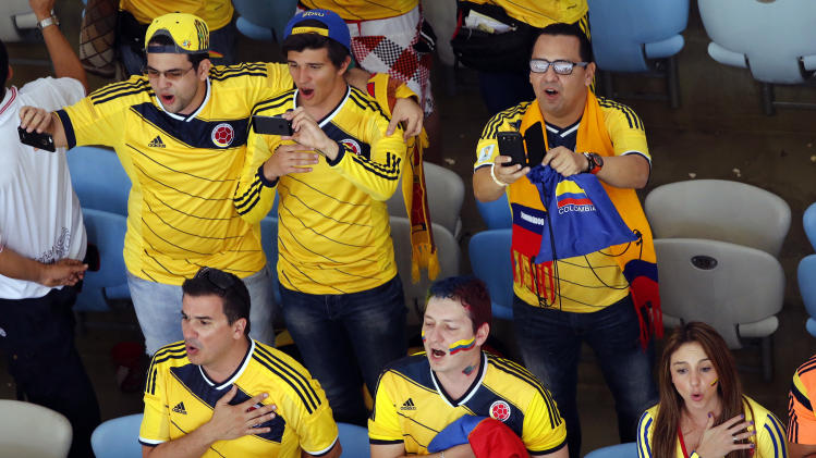 Colombia fans sing their national anthem prior to the World Cup round of 16 soccer match between Colombia and Uruguay at the Maracana Stadium in Rio de Janeiro, Brazil, Saturday, June 28, 2014. (AP Photo/Fabrizio Bensch, Pool)