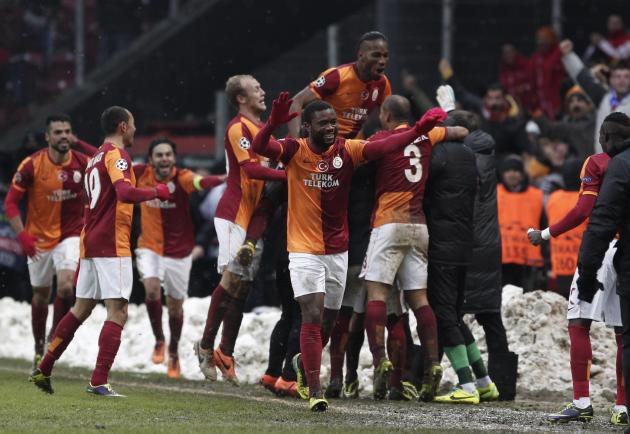 Galatasaray players celebrate their goal against Juventus during their Champions League soccer match in Istanbul