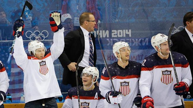 Team USA player reacts from the bench after a goal by forward Phil Kessel during the third period of men's quarterfinal hockey game against the Czech Republic in Shayba Arena at the 2014 Winter Olympics, Wednesday, Feb. 19, 2014, in Sochi, Russia