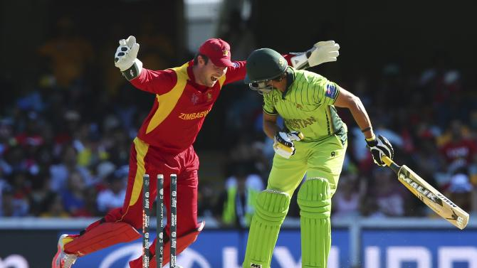 Zimbabwe wicket keeper Brendan Taylor , left, celebrates the wicket of Pakistan's Shahid Afridi during the Pool B Cricket World Cup match in Brisbane, Australia, Sunday, March 1, 2015. (AP Photo/Tertius Pickard)