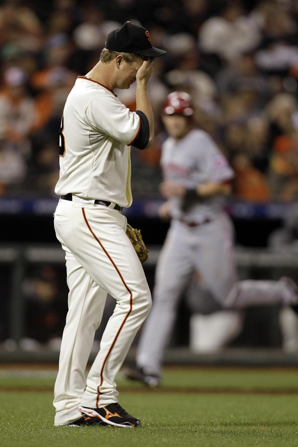 San Francisco Giants pitcher Matt Cain reacts after giving up a two-run home home to Cincinnati Reds' Brandon Phillips in the third inning of Game 1 of the National League division baseball series in San Francisco, Saturday, Oct. 6, 2012. (AP Photo/Eric Risberg)