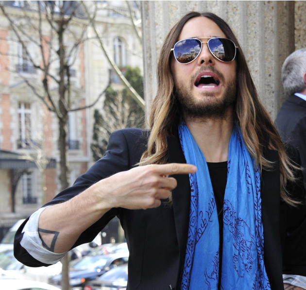 American actor Jared Leto arrives at Miu Miu's ready to wear fall/winter 2014-2015 fashion collection presented in Paris, Wednesday, March 5, 2014. (AP Photo/Zacharie Scheurer)