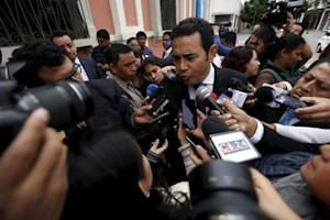 Guatemalan presidential candidate Jimmy Morales of the National Convergence Front, speaks with the media outside the Supreme Electoral Tribunal in Guatemala City