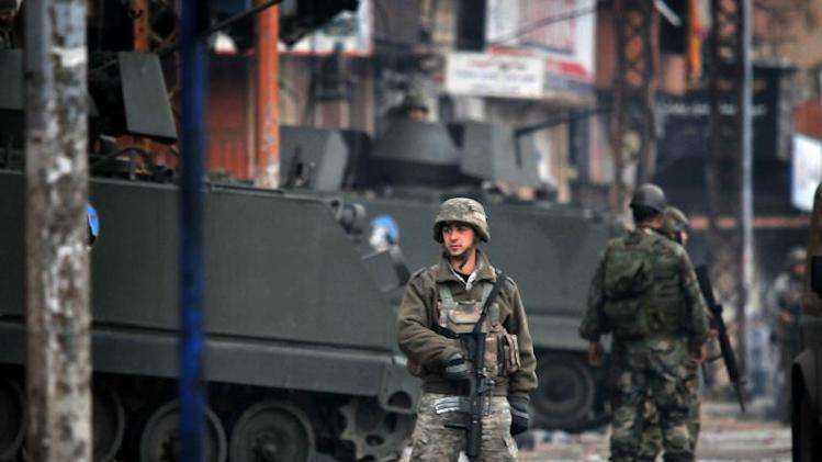 Lebanese army soldiers patrol a street in the northern Lebanese city of Tripoli on December 4, 2013