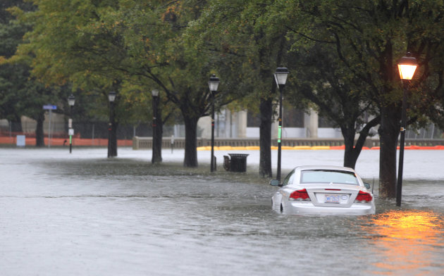 A stranded car sits parked along a street near downtown Norfolk, Va., Monday, Oct. 29, 2012. Rain and wind from Hurricane Sandy are hitting the area. (AP Photo/Steve Helber)