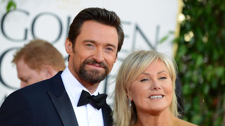 Actor Hugh Jackman, left, and Deborra-Lee Furness arrive at the 70th Annual Golden Globe Awards at the Beverly Hilton Hotel on Sunday Jan. 13, 2013, in Beverly Hills, Calif. (Photo by Jordan Strauss/Invision/AP)