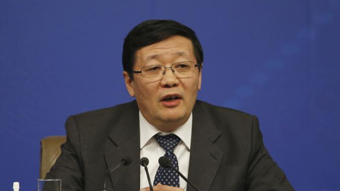 China's Finance Minister Lou Jiwei speaks at a news conference in Beijing
