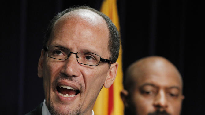 United States Assistant Attorney General Thomas Perez, left, who heads up the civil rights division at the Department of Justice, is joined by Deputy Assistant Attorney General for Civil Rights, Roy Austin, as Perez announces a federal civil lawsuit against Maricopa County Sheriff Joe Arpaio during a news conference Thursday, May 10, 2012, in Phoenix.  The move came after months of negotiations failed to yield an agreement to settle allegations that his department racially profiled Latinos in his trademark immigration patrols.  (AP Photo/Ross D. Franklin)