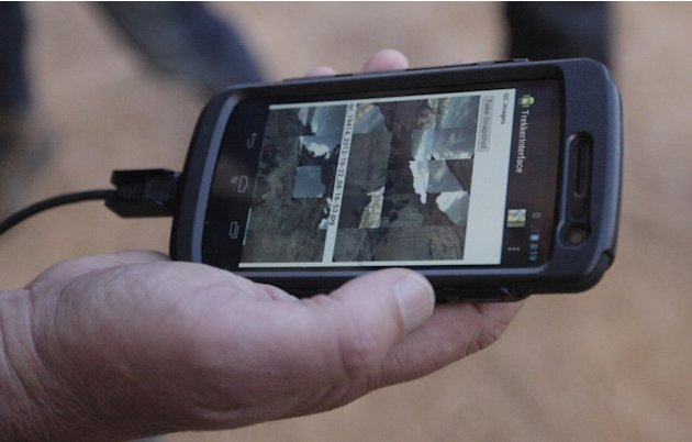 In this Monday Oct. 22, 2012, photo, Google operations manager Steve Silverman shows low-resolution images of photos gathered by the Trekker on an Android phone during a demonstration for the media al