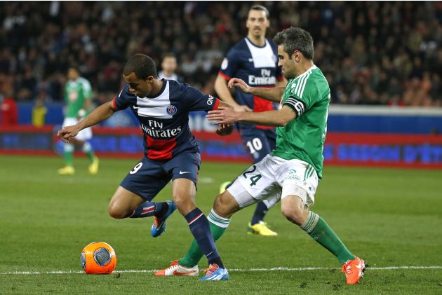 Paris St Germain's Lucas challenges St Etienne's Loic Perrin during their French Ligue 1 soccer match at the Parc des Princes Stadium in Paris
