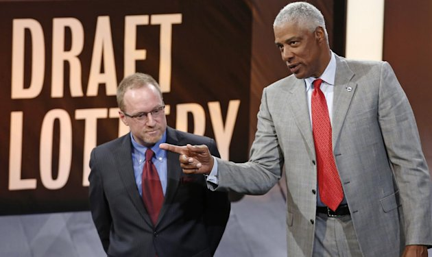 Cleveland Cavaliers general manager David Griffin, left, listens as he speaks on stage with Philadelphia 76ers adviser Julius Irving during the NBA ba...